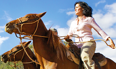 Cuban woman riding horse.